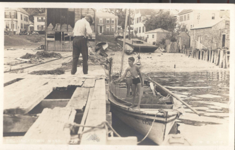 Boy in a boat  at dock