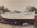 Color photograph of the trapboat Charlotte after restoration